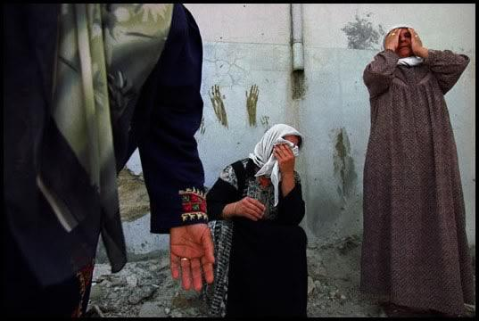 West Bank, 2002 - Mourning the dead in Jenin refugee camp.